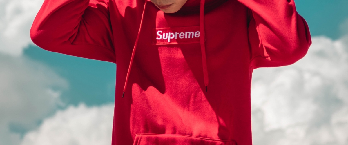 Teenager wearing a Supreme hoodie