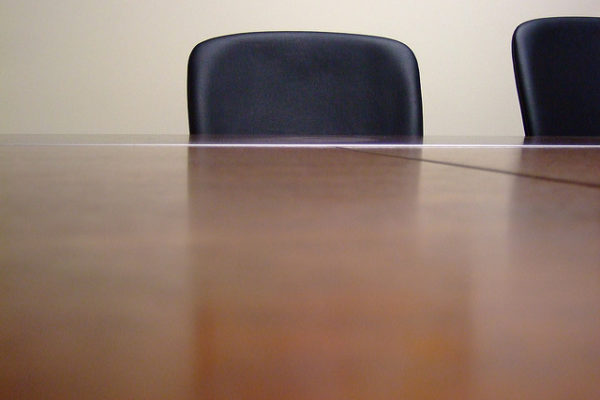 Empty chair at a business meeting