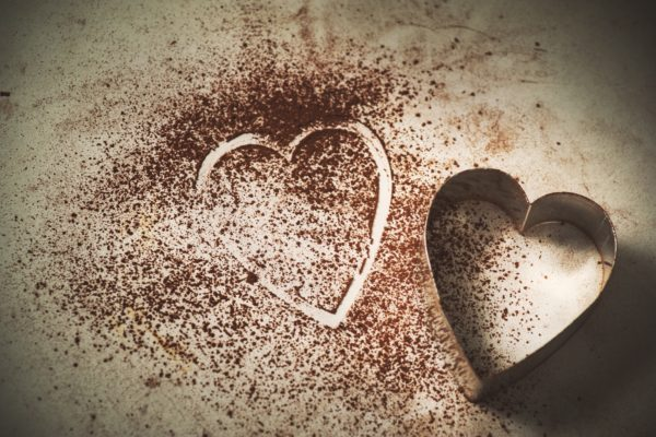 Heart shaped cookie cutter in coco powder