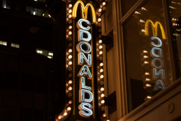 Neon sign that reads 'McDonalds'