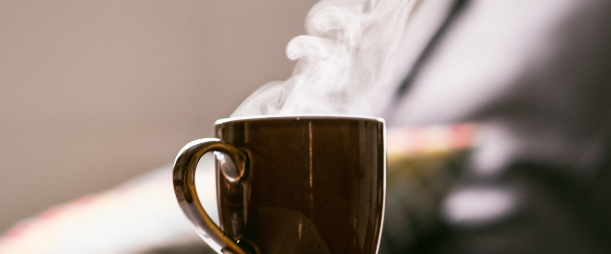 Brown hot coffee cup steaming peacefully