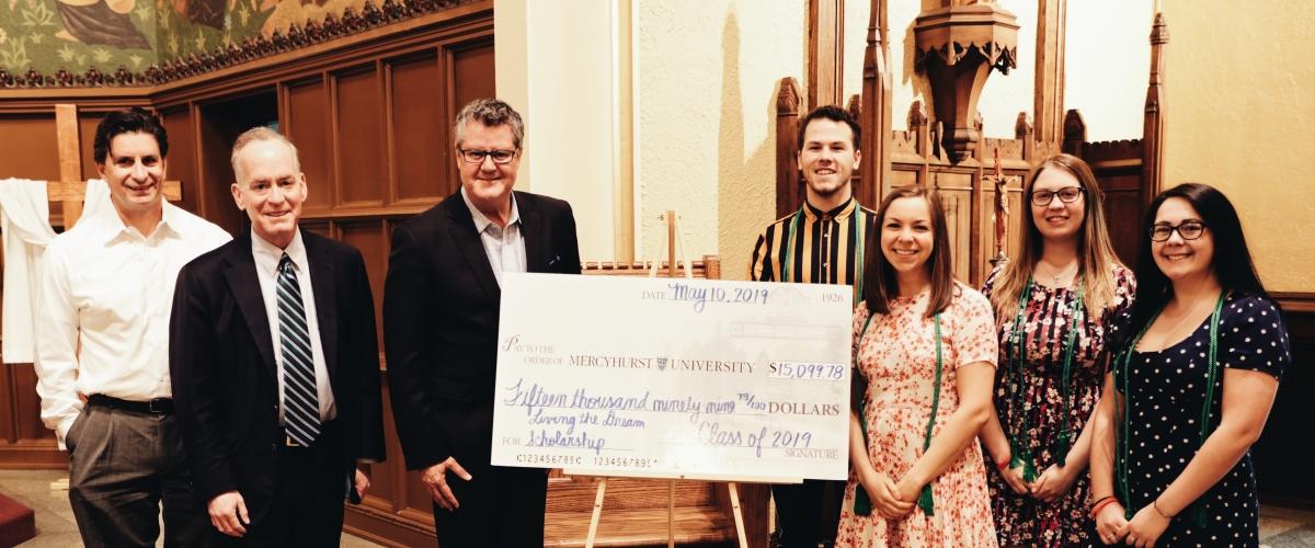 Curtis Zimmerman awarding the Living the Dream scholarship