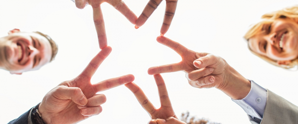 fingers forming a star in a short and fun meeting