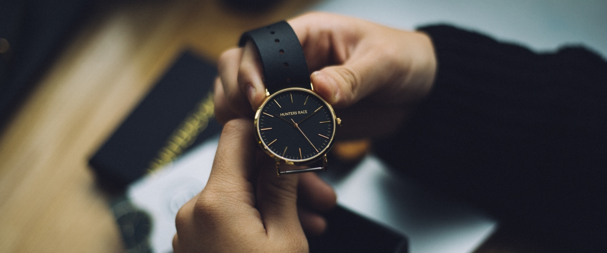 Holding a black watch